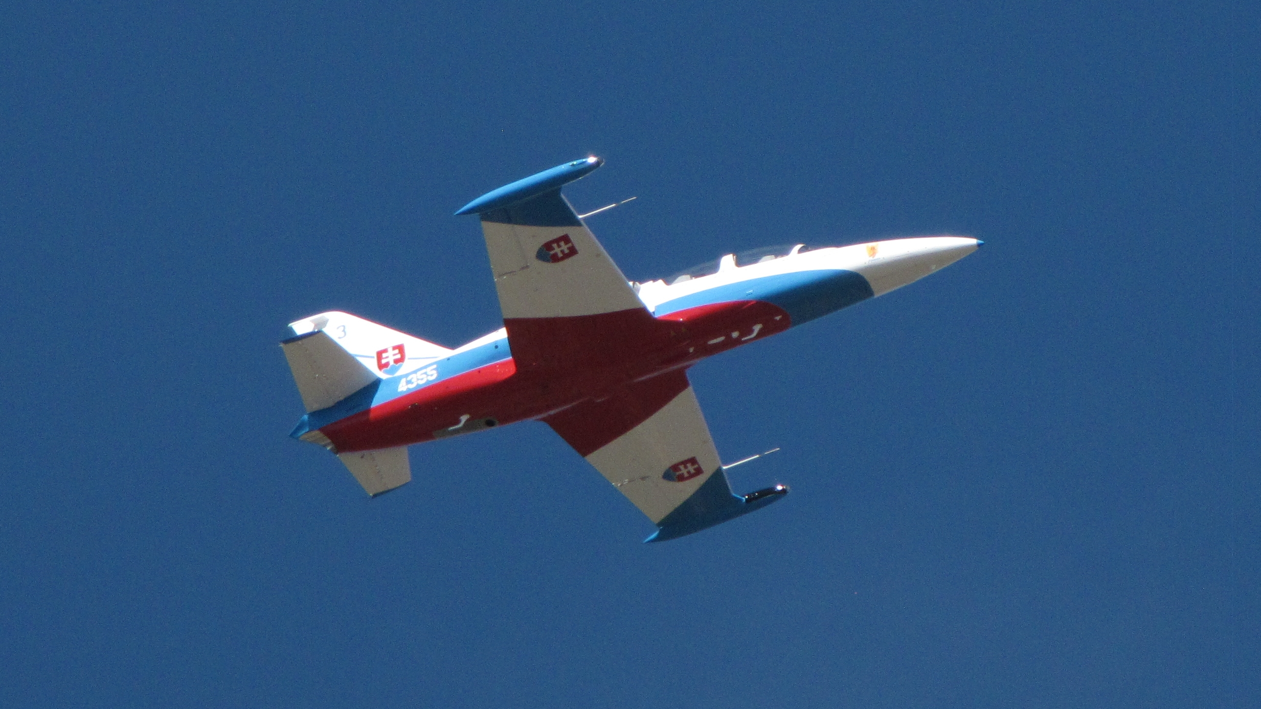 Above: Jet trainer from Slovakia seen from the Bay Area Park boardwalk over Armand Bayou in the area of Houston Texas USA. (Click to zoom.) Image credit: Douglas Yazell.